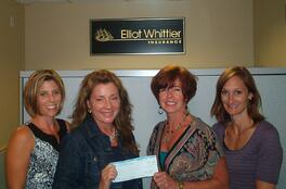 Founder of Friends and Family, Linda Vecchia, accepting $500 donation from Elliot Whittier Insurance staffers.  Pictured here are Suzanne Noiles Chiudina, Chris Millerick,  Vecchia, and Amy Roy Olevitz.
