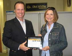 iPad winner Cathy McKenna with Steve Roy, CEO of Elliot Whittier Insurance