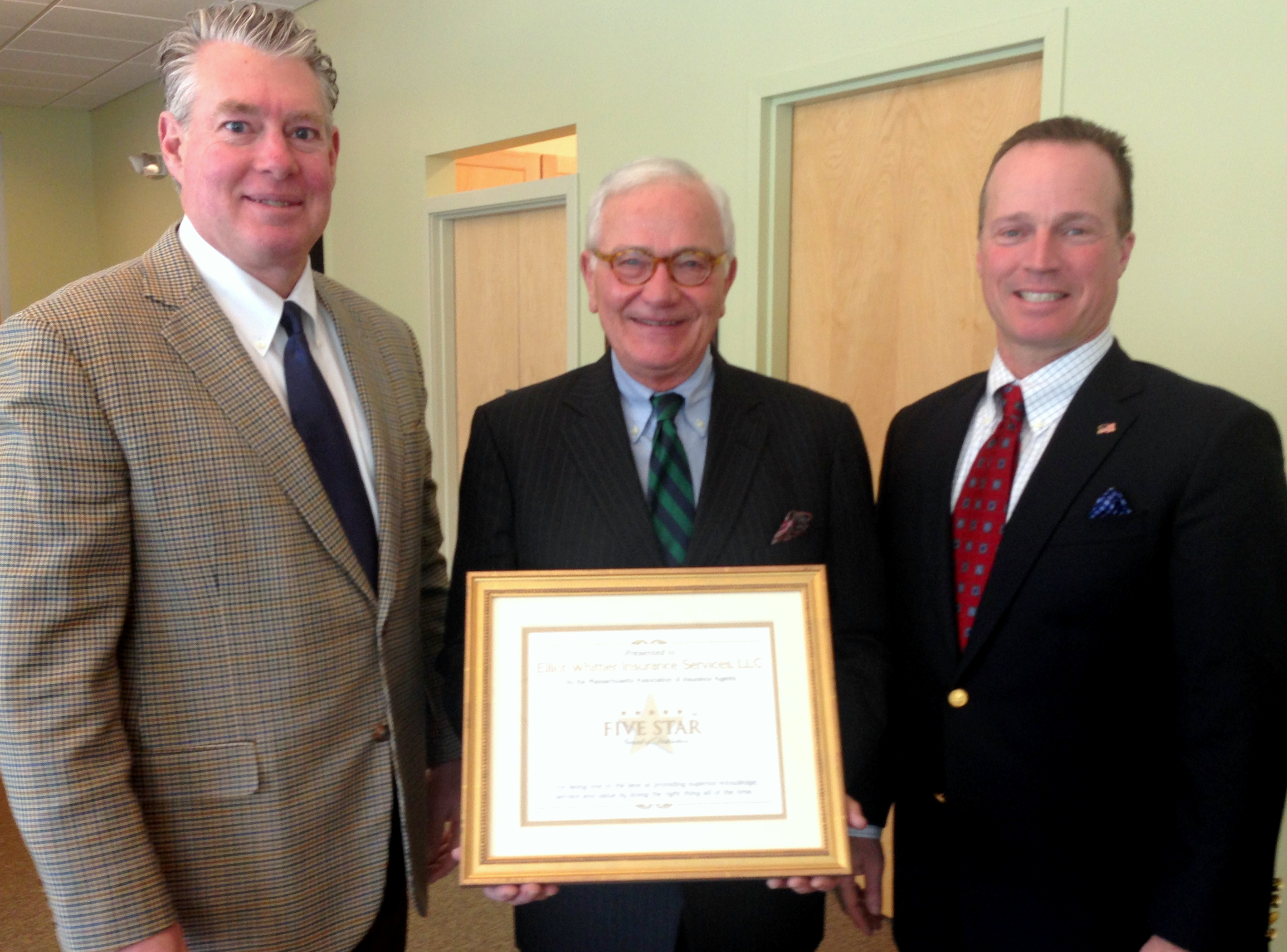 Elliot Whittier Insurance Receives 5 Star Designation from Frank Mancini MAIA.  Shown here are Wayne Guyer, Frank Mancini, and Steve Roy
