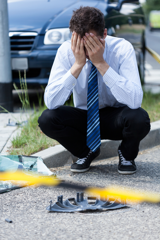 who pays if you lend your car and it gets in an accident Elegant man crying at accident scene, vertical