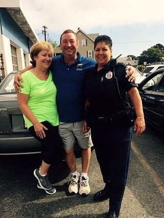 Judy Hanlon getting her car seat check with Winthrop Police officers Carter & Racow