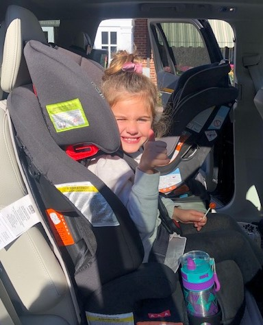 Little Miss Sadie giving the thumbs up on her car seat check