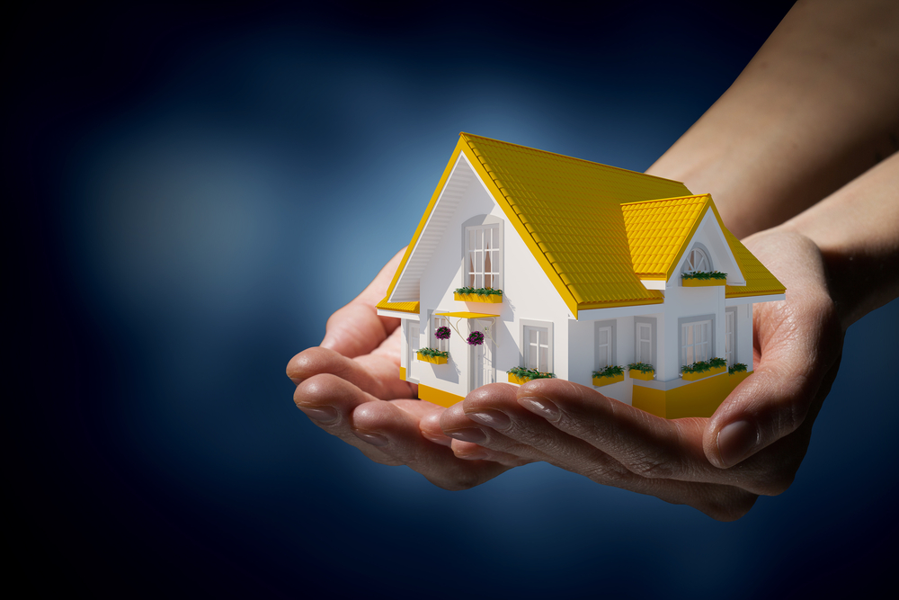 What does my home insurance cover and what is not covered under my home insurance?  Model of a pretty white and yellow house.